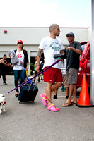 Miguel Cotto arrives at the Don Miguel Boxing Gym in Orlando with one of his French bulldogs and wife Melissa in backround