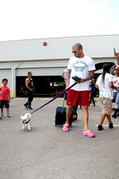 Miguel Cotto arrives at the Don Miguel Boxing Gym in Orlando with one of his French bulldogs